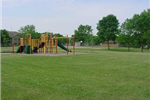 Brightly colored playground equipment at Firemans Park