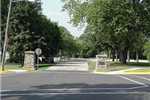 Stone pillars mark the entryway to Clausen Park